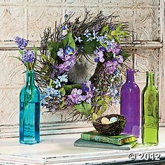Pleasingly Purple  Want to freshen up a room without a complete makeover? Try this pretty purple duo. A set of glass bottle vases and a purple flower wreath create a bright ambiance that will perk up your room any time of year.