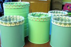 Fabric Lined spray painted cans from  this tute:-http://pickupsomecreativity.blogspot.com/2010/09/repurposed-fabric-lined-can-tutorial.html
