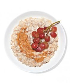 Oatmeal With Peanut Butter and Grapes: Mimic the irresistible flavors of a peanut butter and jelly sandwich by stirring a spoonful of your favorite natural nut butter and fresh red grapes into a steaming bowl of oatmeal. This portable treat is perfect for breakfast or a midday snack and, thanks to all the protein, will keep you full for hours.