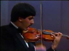Sibelius Violin Concerto: LEONIDAS KAVAKOS performing with the Finnish Radio Symphony Orchestra conducted by Jukka-Pekka Saraste, 1990. Some of the spartan austerity heard in his utterly unique recordings for BIS can be heard in this remarkable performance. This is near perfection. (KevinR@Ky)