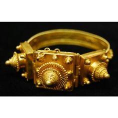 Bracelet Date: Mid-20th century Medium: Gold Dimensions: H x W x D: 8 x 6.5 x 2.2 cm (3 1/8 x 2 9/16 x 7/8 in.) Credit Line: Gift of Dr. Marian Ashby Johnson Geography: Senegal
