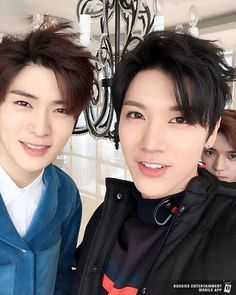 Ten and Jaehyun with Taeyong lurking in the background