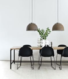 Morten Bo Jensen, of Danish industrial design company Vipp, and his partner, graphic designer Kristina May Olsen, have mixed repurposed vintage items with their own creations inside their Copenhagen apartment. In the kitchen, the dining table—Jensen's first piece for Vipp—is made of a powder-coated aluminum frame with a recycled, untreated teak top. The lamps overhead are salvaged and rewired Copenhagen streetlights. photos by: Anders Hviid