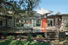 A 1960s home with an unusual awning gets upgraded with 21st-century conveniences while maintaining its Austin street cred.