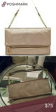 Foldover Metallic Clutch Turn heads as you accessorize your outfit with this beautiful, metallic Fossil clutch. Fossil Bags