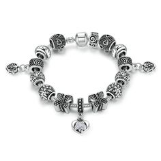 Antique Silver Plated Charm Bracelet with 14 Beads & Heart Pendant. Available in 2 sizes, this bracelet features 14 Beads & Heart Pendant. The bracelet Vintage Charm Bracelet, Silver Charm Bracelet, Silver Charms, 925 Silver, Silver Beads, Antique Silver, Bangle Bracelets, Bangles, Fashion Jewelry