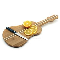 Guitar Shaped Cutting Board: Made from bamboo, the wood is 16% harder than traditional maple cutting boards, which prevents scoring. Get it HERE: http://www.thegiftsformen.com/guitar-shaped-cutting-board.php