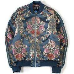 Gigi Hadid wearing Adidas Originals X Pharrell Williams Jacquard Jacket in St Stonewash Blue