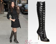 Selena Gomez was photographed greeting fans before her David Letterman appearance, wearing a pair of striking Brian Atwood 'Electra' Cutout Knee-High Boots in color Black. These boots are on sale from SaksFifthAvenue.com for $1,750.  Buy them HERE  She's also wearing a Burberry trench coat.