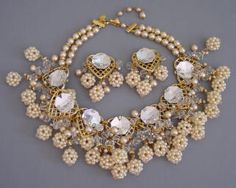 VRBA   necklace and earrings of artificial pearls, clear rhinestones set in  gold tone, necklace 18 by 3, earrings 2-1/2. This is like a Haskell  with it lush feel and intricate work, but much larger.