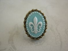 Antoinette Poison ring with an Aqua  Fleur de Lis by TheQuietbee, $18.00