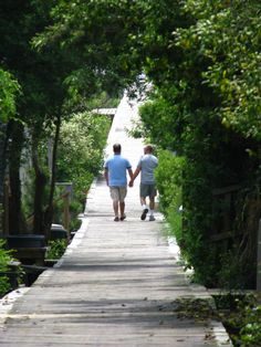 Fire Island Gay Guide and Photo Gallery: Couple strolling along a boardwalk in Cherry Grove