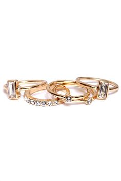 Set for Life Gold Rhinestone Ring Set: You can sit back and relax now that youve found the ring set to rule them all. Five shiny golden bands each offer a unique dose of diamond-like rhinestones to create a stunning ring set that can be worn all together or separate. Rings are sized $12.00