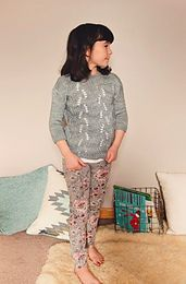 The pullover features a surprisingly easy rib pattern with yarn overs on the body, and an eye catching bottom line. The pullover is constructed from the bottom up with set-in-sleeve. It is so comfortable that kids will love to wear this pullover everyday!