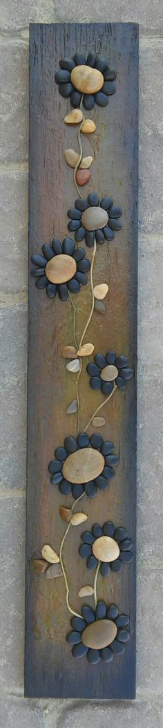 Original pebble/rock art (string of beautiful black flowers) handmade from all natural materials including reclaimed wood, pebbles, twigs by CrawfordBunch on Etsy