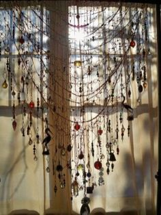 Add a bead & crystal curtain to any window for that boho chic look.