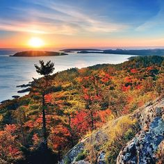 We're dreaming about autumn in #PureMichigan. In a few weeks, this will be the stunning view from Sugarloaf Mountain near Marquette, with the sun rising over Partridge Island in Lake Superior. Tag someone you'd love to take here. #PureMichigan #UpperPeninsula #LakeSuperior #autumn #travel