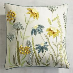 No meadow in your ZIP code? No worries. We& gathered freshly picked wildflowers to create a pretty pastoral focal point for your sofa or accent chair. The cotton cover features embroidered and appliqued blooms in soothing blues, greens and yellows. Cushion Embroidery, Crewel Embroidery Kits, Embroidered Cushions, Hand Embroidery Patterns, Ribbon Embroidery, Embroidery Supplies, Floral Pillows, Decorative Pillows, Cushion Cover Designs