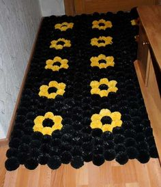.plastic bag recycled for rugs, Pom poms, crocheted, and woven. Great for entry ways. Marie
