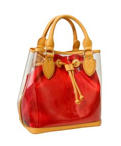 This NFL and PGA security compliant D by Dominie Tote Features a Rococo Red Detachable liner