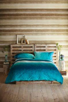 Tête de lit en palette de bois