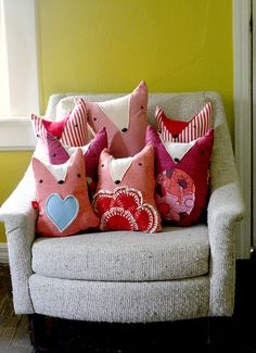 A cute pile of fox pillows...looks great on a bed or in a chair...could do this with other animal pillows, too.