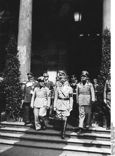 Mussolini and Hitler, Munich Conference, Germany, 29 Sep 1938; Göring, Himmler, and Ciano in background  Source	   	German Federal Archive