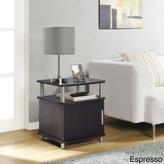 Add valuable functionality and style to your space with this pretty wooden storage end table. This table is equipped with silver metal hardware and accents and features a door that hides your items from view for a neat and tidy appearance in any room.