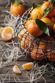 Sweet fresh tangerins on the vintage table by OxanaDenezhkina