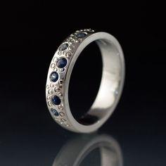 Blue Sapphire Wedding Band, Star Dust Wedding Ring in Sterling Silver, Palladium, Platinum and Gold, Womens Wedding Band by NodeformWeddings on Etsy https://www.etsy.com/listing/108826160/blue-sapphire-wedding-band-star-dust