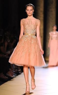 Lebanese couturier Elie Saab experimented with sheer fabrics to display an intricate overlay of beadwork - in order to preserve the wearer's modesty of course.