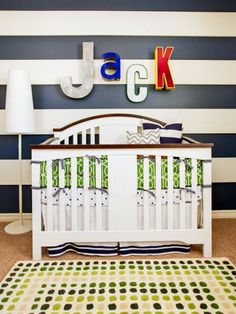 "A favorite decoration for a nursery is hanging a monogram or the child's name above the crib. Designers Jennifer O'Dowd and Joanna Gick of J&J Design Group create a one-of-a-kind look with vintage letters that add dimension and bold color to the wall. ""Antiques give you an opportunity to make the space unique to you. Vintage items bring an interest that is different than your typical space from a catalog,"" says Gick. Photography by John Woodcock"