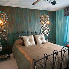 beautiful faux painted wall with teal,brown and metalic copper colors