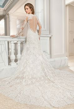 Brides: Demetrios Couture. This classic all lace, a-line gown features a high illusion neckline and long sheer sleeves with lace appliques. The keyhole illusion back features a delicate scalloped lace edging with button closure and chapel train.
