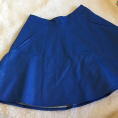 ASTR Skirt ASTR Skirt in a faux blue leather high waist and flowy bottom, two pockets, a zipper in back. In excellent unused condition! Skirts