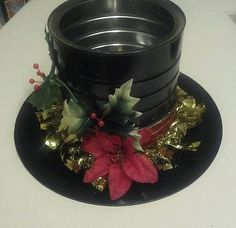 Looks like black foam for rim, metal coffee can for hat and decoration.