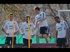 Argentina's national football team forward Lionel Messi jumps while teammates Erik Lamela (L), Maximiliano Rodriguez and Ezequiel Lavezzi (R) wait for their turn during a training session in Ezeiza, Buenos Aires, on September 6, 2013. Argentina will face Paraguay on September 10 in Asuncion in a Brazil 2014 FIFA World Cup South American qualifier match.