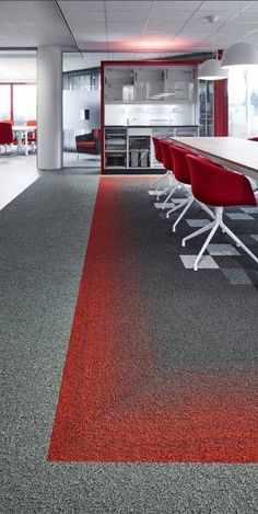 We like this red interior design at Häfele, Netherlands. Fuse is a striking carpet tile that adds movement to the floor by effortlessly flowing between two contrasting yet complimentary colour schemes to help zone and divide large interior spaces such as open plan offices.