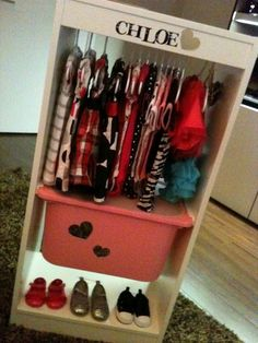 A Ikea bookcase made into a dress up clothes cabinet for a little girl.