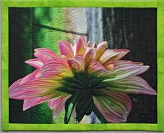A back-lit dahlia I grew in my garden is the subject of an art quilt by Barbara Barrick McKie