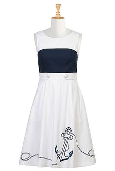 An emmbellished anchor at the flared skirt accentuates the nautical look of our colorblock cotton poplin dress styled with button tabs at the banded waist.