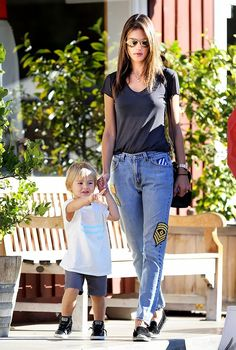 Alessandra Ambrosio in her signature Cali babe laid-back style in patchwork slouchy jeans, slouchy  t-shirt, and espadrille flats.