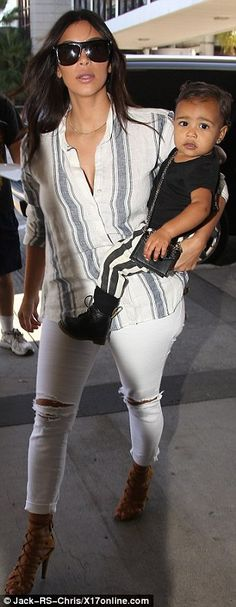 Supporting her man: The day before, Kim watched her husband headline Budweiser's Made In A...