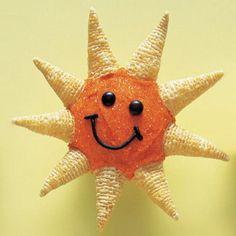 Sun cupcakes made with orange sugar and Bugles.