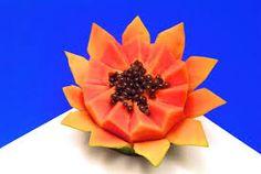 Resultado de imagem para carving papaya