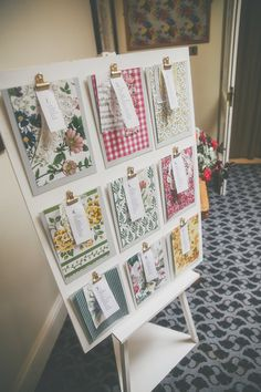 Different patterned clip board table plan - Image by  Millie Benbow Photography - A Phase Eight wedding dress for a vintage inspired village hall wedding with handpicked wild flowers and floral bridesmaid dresses.