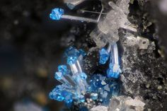 Penfieldite, Pb2Cl3(OH), and Diaboleite (blue), Thorikos Bay slag locality, Thorikos area, Lavrion District slag localities, Lavrion District, Attikí Prefecture, Greece. Fov 1.4 mm. Collection/Photo Serge Lavarde
