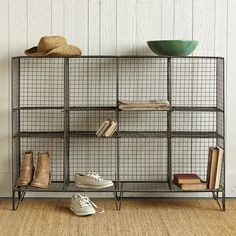 """STOREWELL LOW STORAGE SHELF--Recently revamped, this free-standing storage unit is sturdier than ever before. Mix and match to suit your needs and let the vintage visage bring new world order to your home. Imported. Catalog exclusive. Assembly required. 48""""W x 12""""D x 34""""H. Additional shipping, $20.  We have one in the warehouse for $300."""