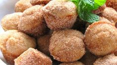 Little nutmeg-scented mini muffins are rolled in cinnamon sugar to make a treat that tastes like a donut and is fast to whip up. You can substitute butter for margarine.