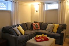 basement | Simply Modern Home love the sectional and colors for the basement